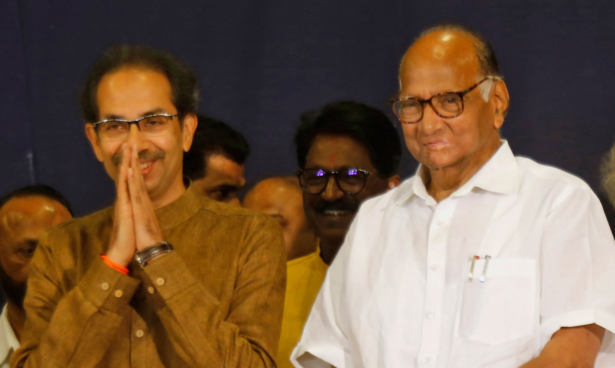 Shiv Sena chief Uddhav Thackeray and Nationalist Congress Party president Sharad Pawar attend a press conference in Mumbai on Saturday, November 23, 2019
