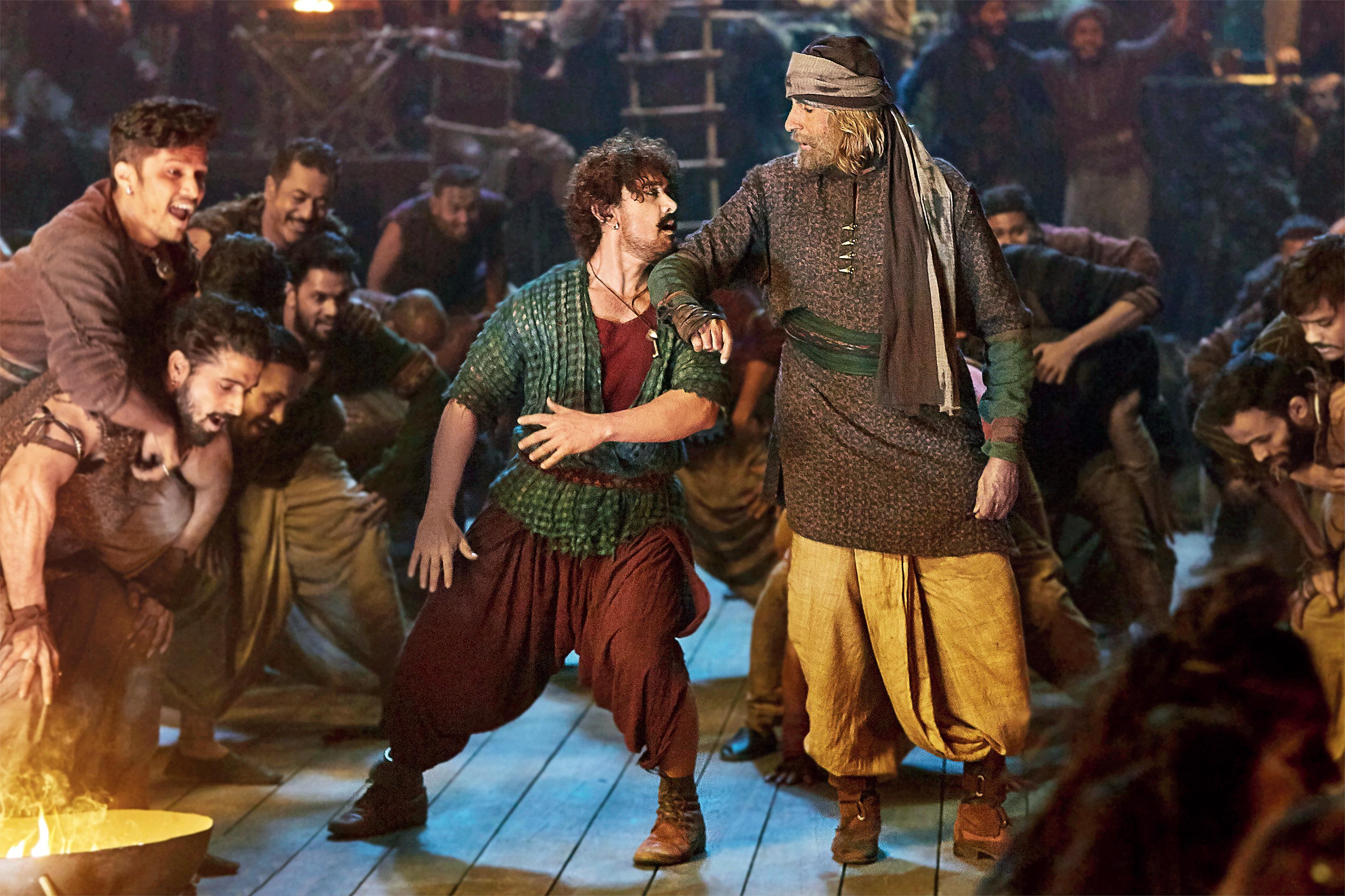 Aamir Khan & Amitabh Bachchan in a still from the film.