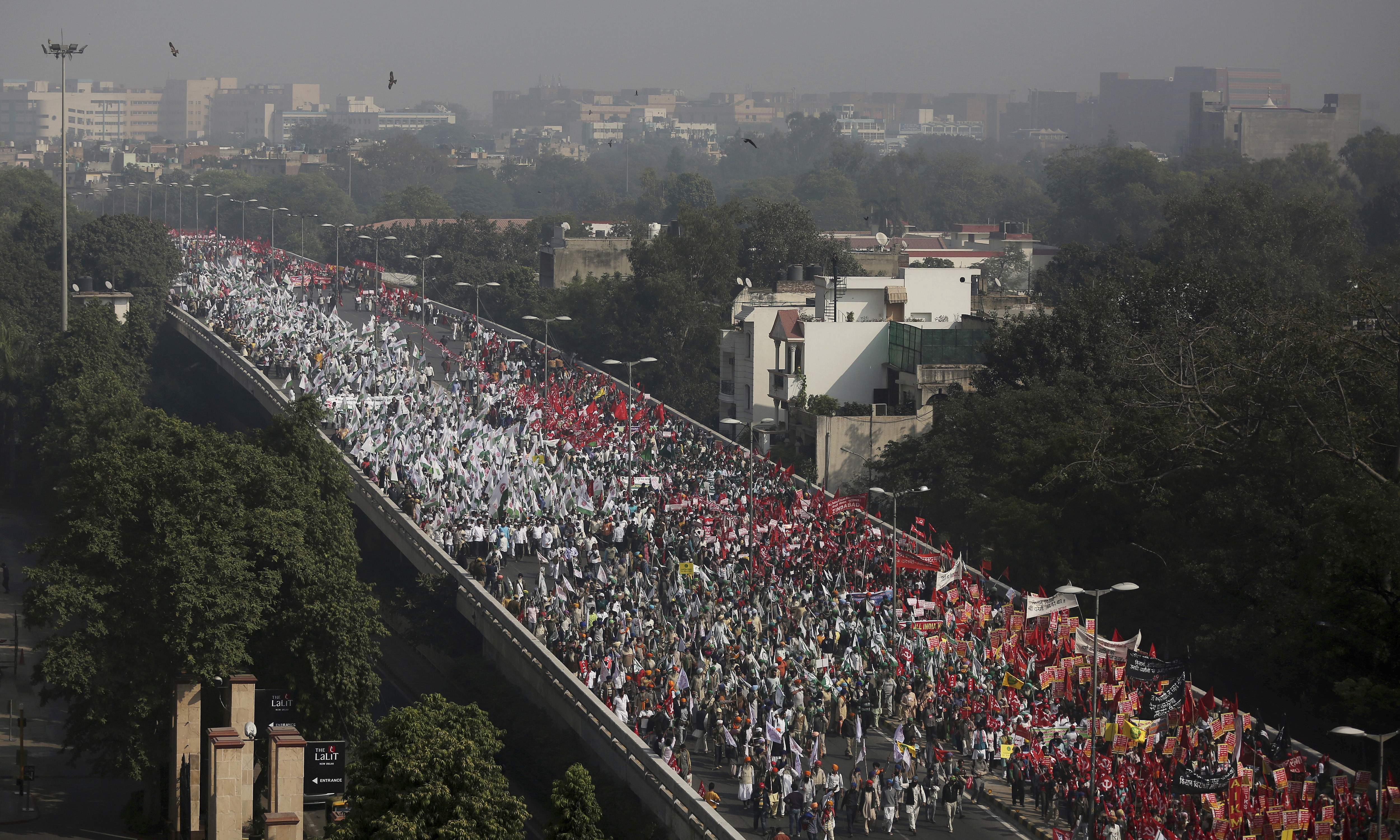 Thousands of farmers march towards Parliament during a protest rally in New Delhi, on Friday, November 30, 2018, demanding higher prices for their produce and a government waiver on their farm loans to alleviate hardships