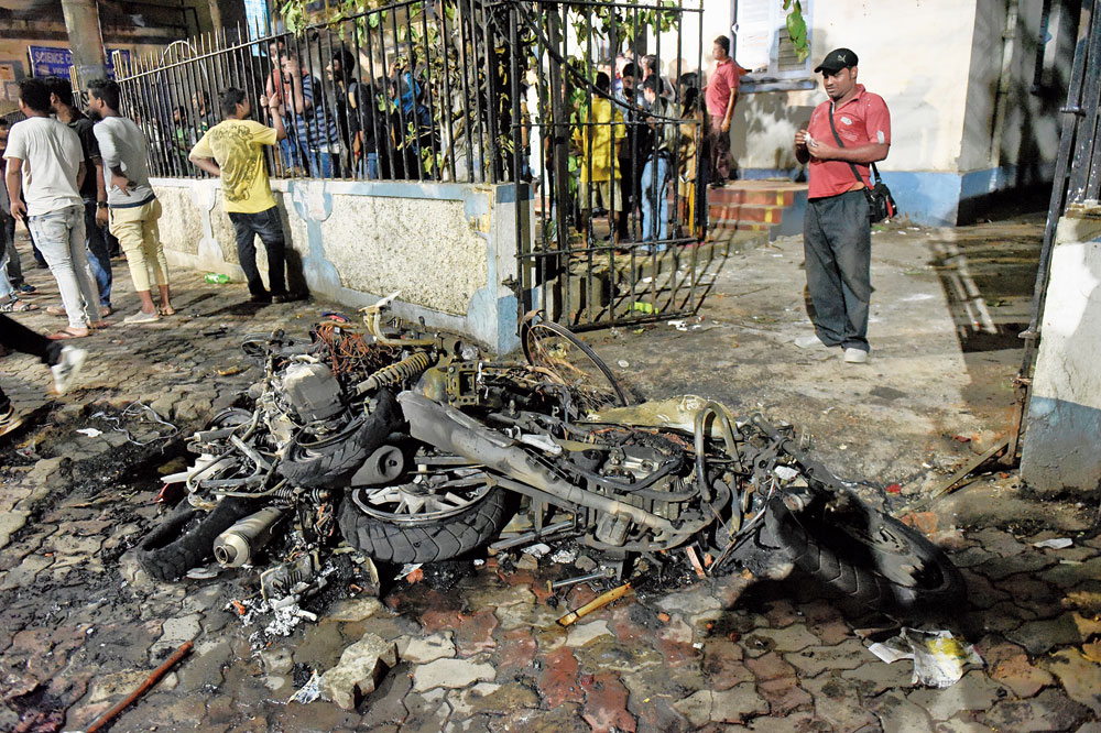 Parts of a bike allegedly set on fire by BJP supporters outside Vidyasagar College