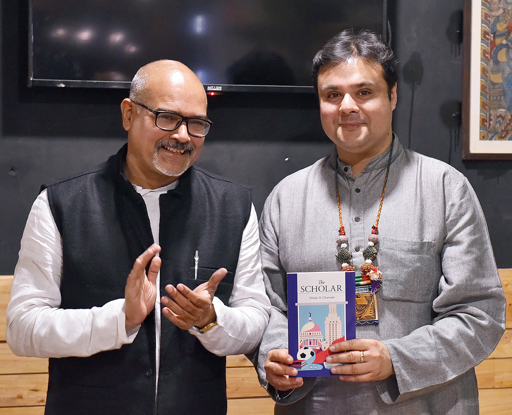 Sujoy Prasad Chatterjee (right), who launched the book with author Niladri Chatterjee at Deshaj cafe, was all praises for 'The Scholar'
