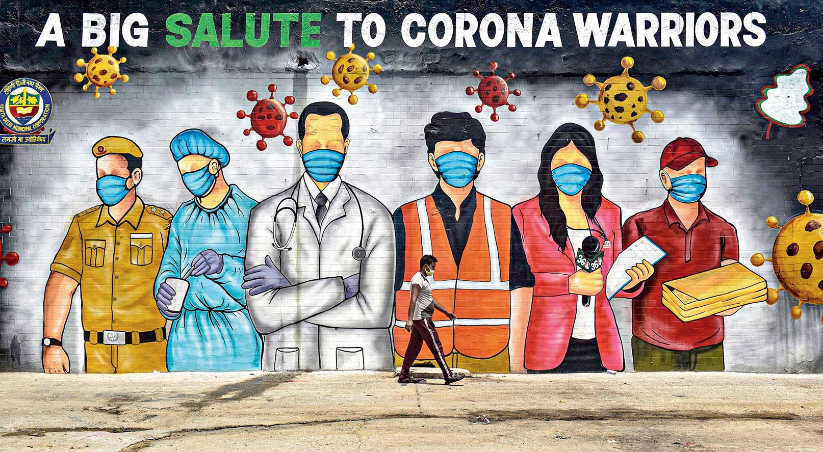 Graffiti on a Delhi wall saluting coronavirus warriors.