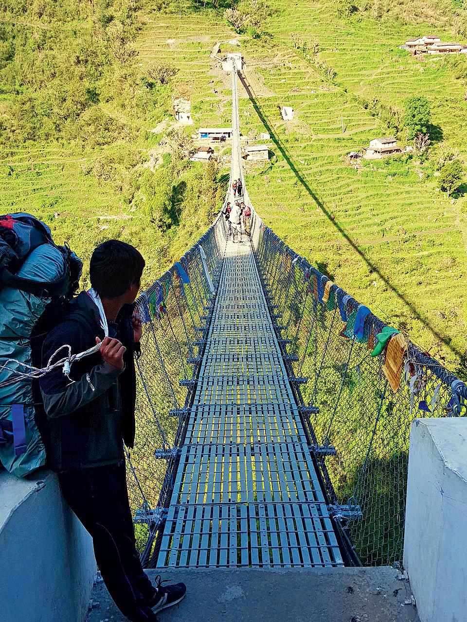 A long hanging bridge spans the Modi River