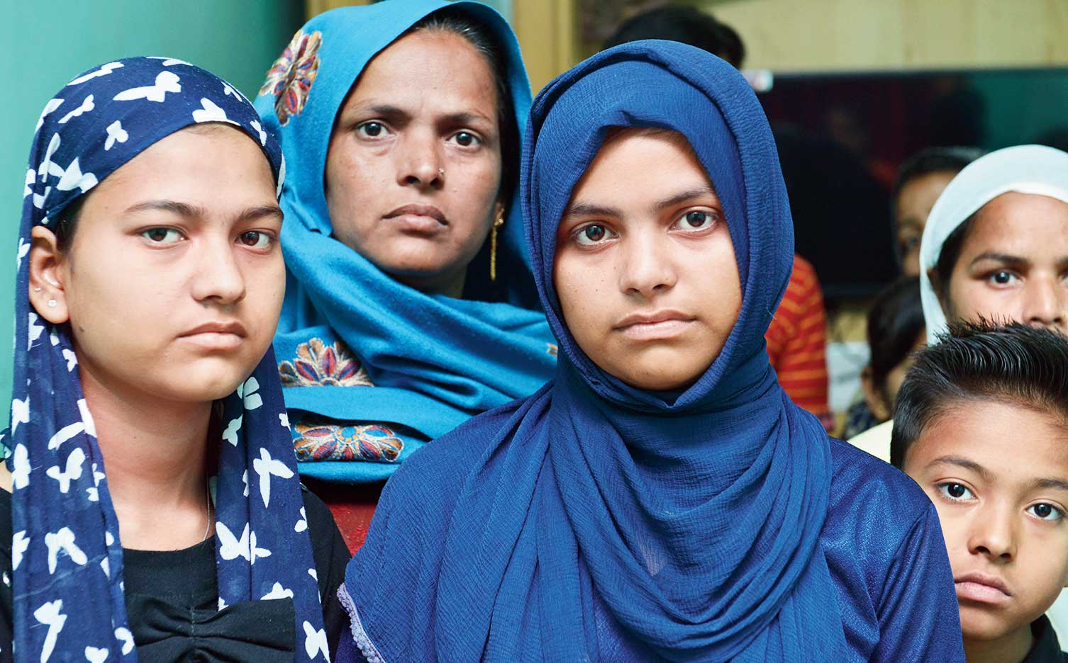 Anam (left), a Class XII student, and her sister Iram with their mother Afsana (centre) in northeast Delhi on Monday. Having lost everything to arson in the riots and little government help trickling to the family, they have been sheltered by a Muslim family in Mustafabad. Bereft of admit cards and school uniform, the two sisters could not appear in the ongoing board examination.
