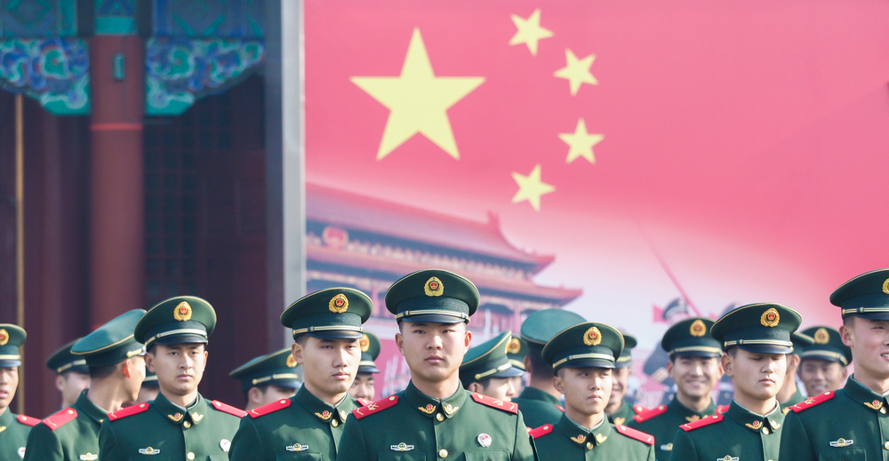 A group of Chinese army soldiers line up in Tiananmen. China's assertion of military and political power in Asia and in the South China Sea and a comprehensive display of economic power globally through the Belt and Road Initiative has ensured it remains the world's second-largest economy.