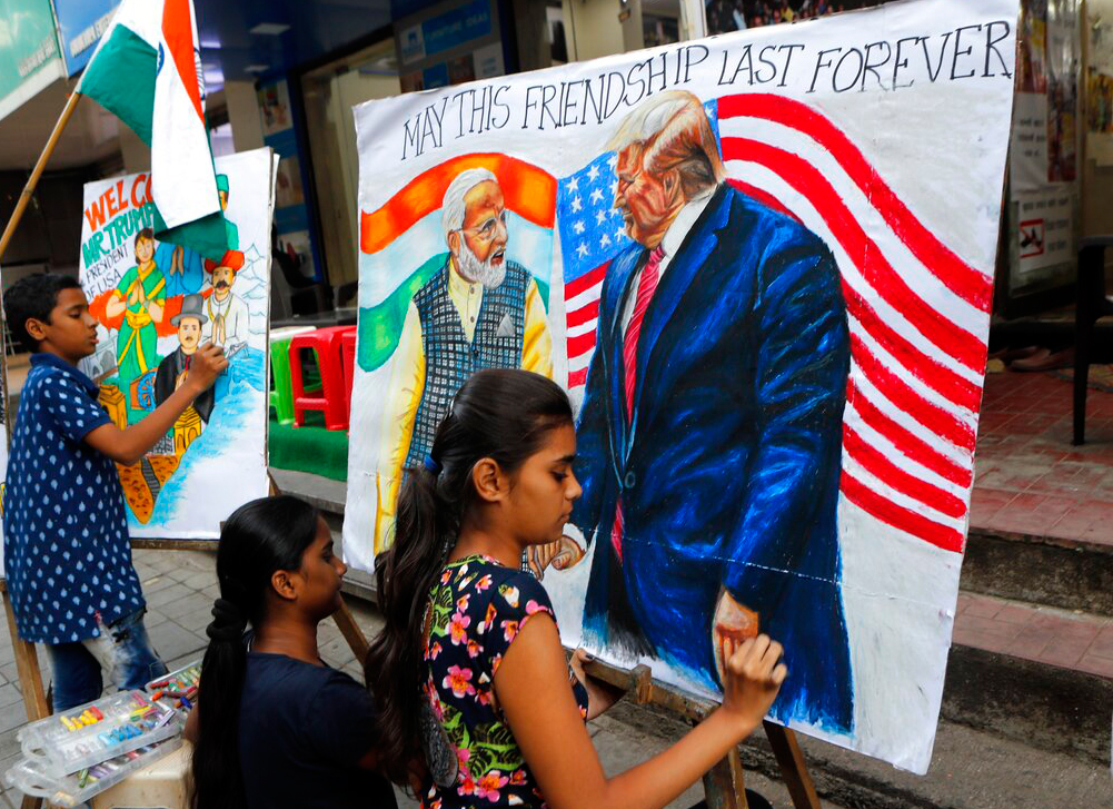 Children from an art school make paintings of US President Donald Trump ahead of his India visit, in Mumbai, Friday, February 21, 2020. Trump is scheduled to visit India February 24-25.