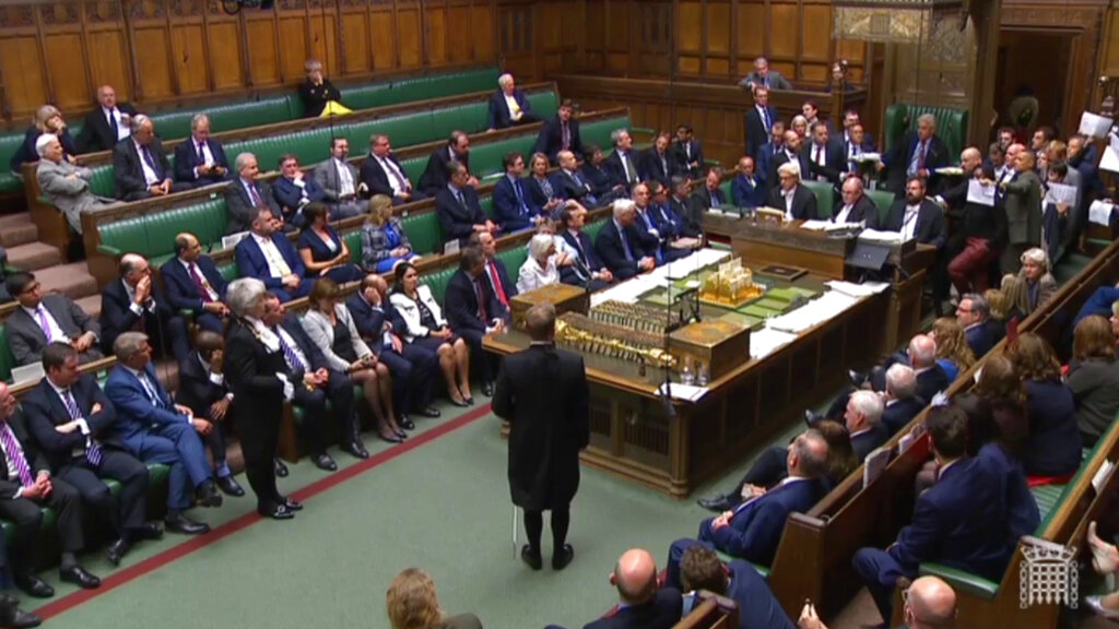 In this image taken from a video, British lawmakers stage a protest in the House of Commons before prorogation of Parliament, in London, on Tuesday September 10, 2019