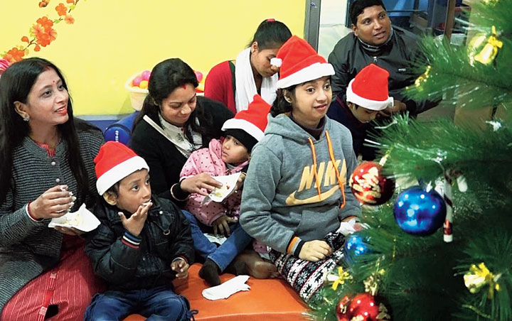 Volunteers celebrate Christmas with Shishu Sarothi children