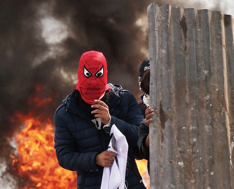 A masked man at the protest site in Srinagar.