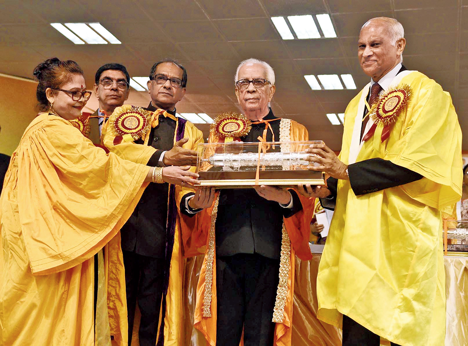 Registrar Sneha Manju Basu, controller of examinations Satyaki Bhattacharya, vice-chancellor Suranjan Das and governor Keshari Nath Tripathi with Mammen Chandy, the director of Tata Medical Center and recipient of an honorary DSc at the JU convocation.