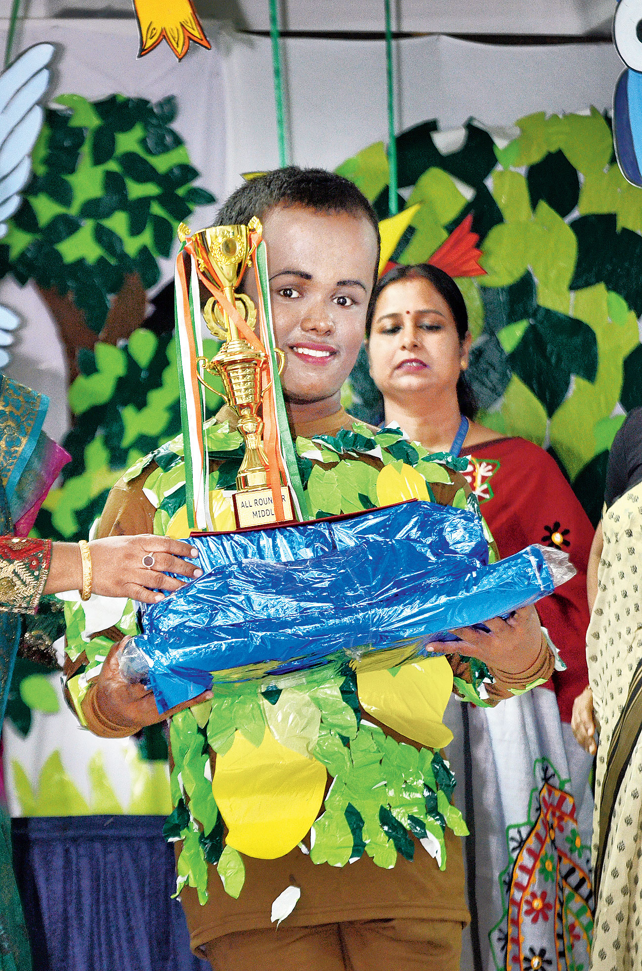 Bittu Sen is a drummer, a member of the school band, an active participant in cultural programmes, a keen student and a leader in child advocacy programmes. He got the middle school all-rounder's award.