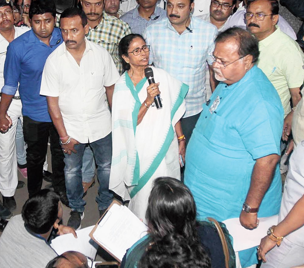 Chief minister Mamata Banerjee and education minister Partha Chatterjee with the protesters at the sit-in off the Maidan on Wednesday evening