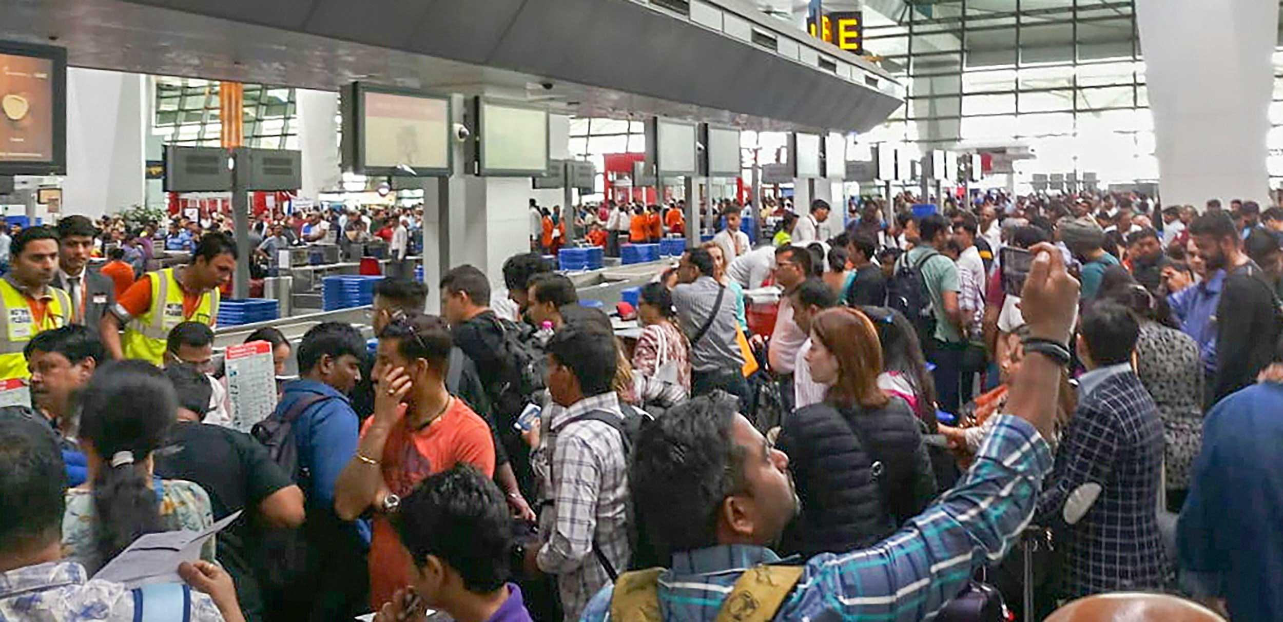 Air India flight passengers stranded at the Indira Gandhi International Airport in New Delhi on April 27, 2019.