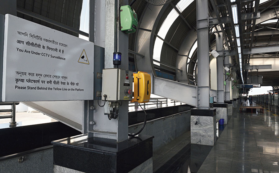 An emergency trip switch on the platform of the Sector V station