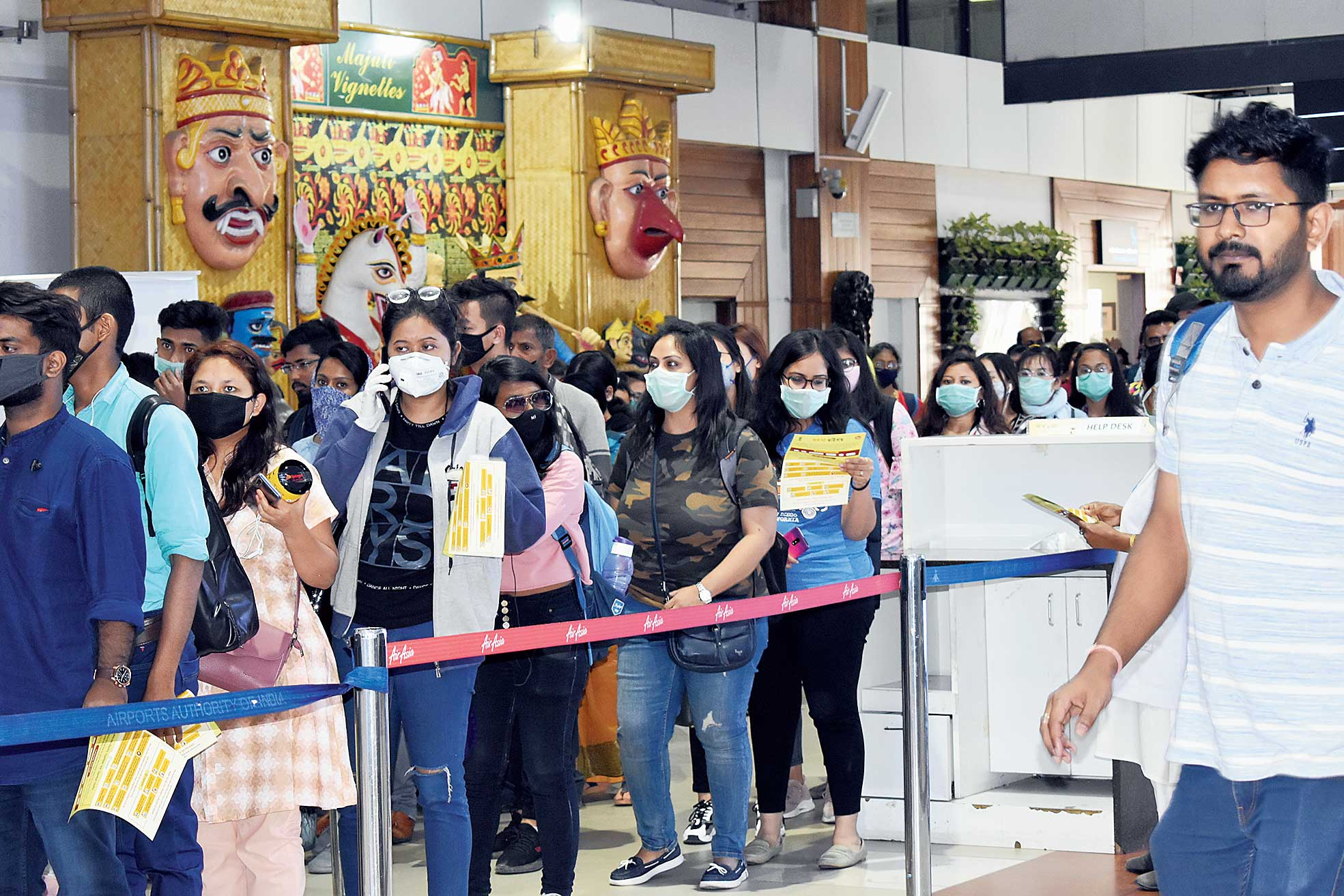 Passengers in queue for a health screening at the Guwahati airport.