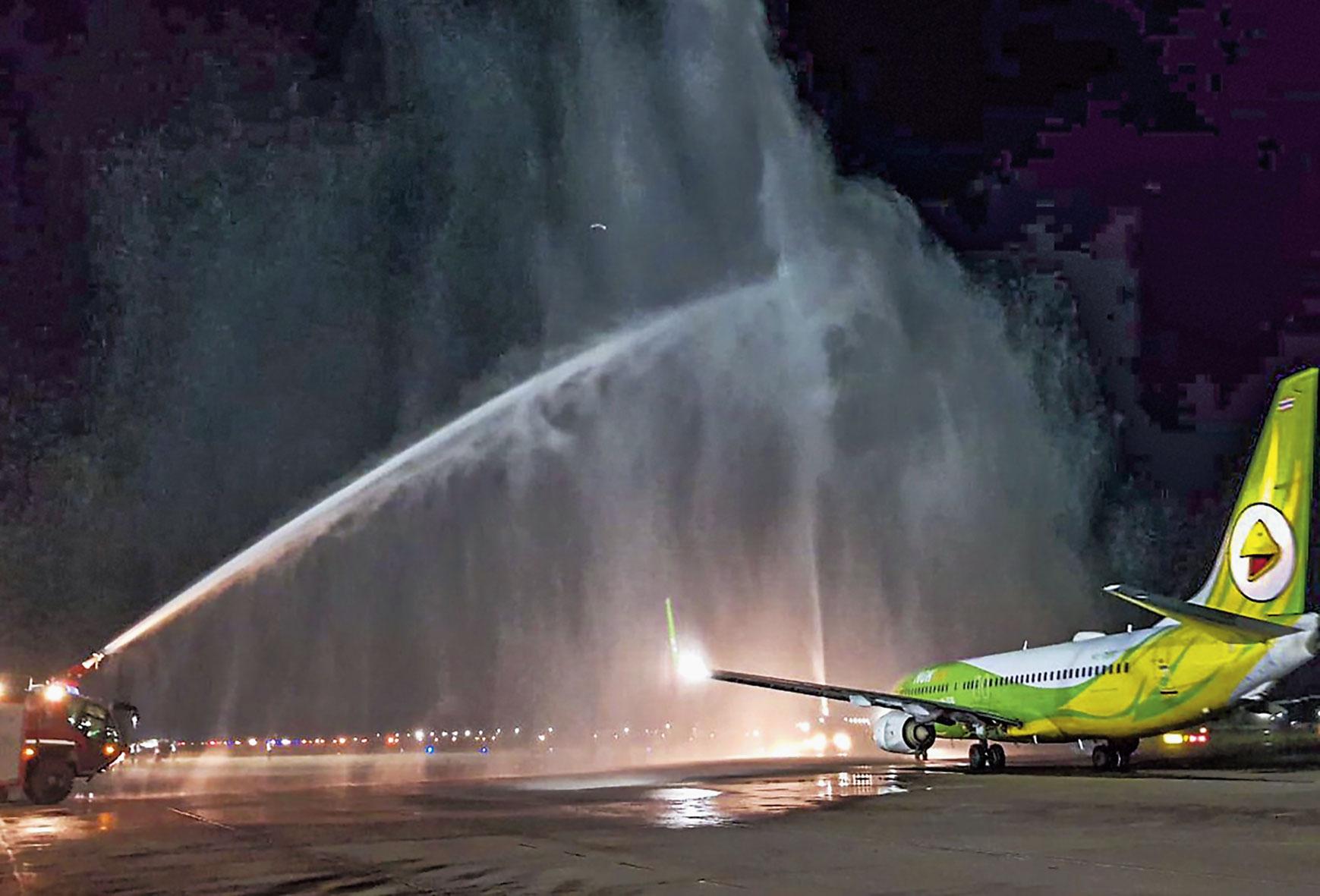 A water salute being accorded to the inaugural Nok Air Guwahati-Bangkok flight at LGBI Airport on Sunday.
