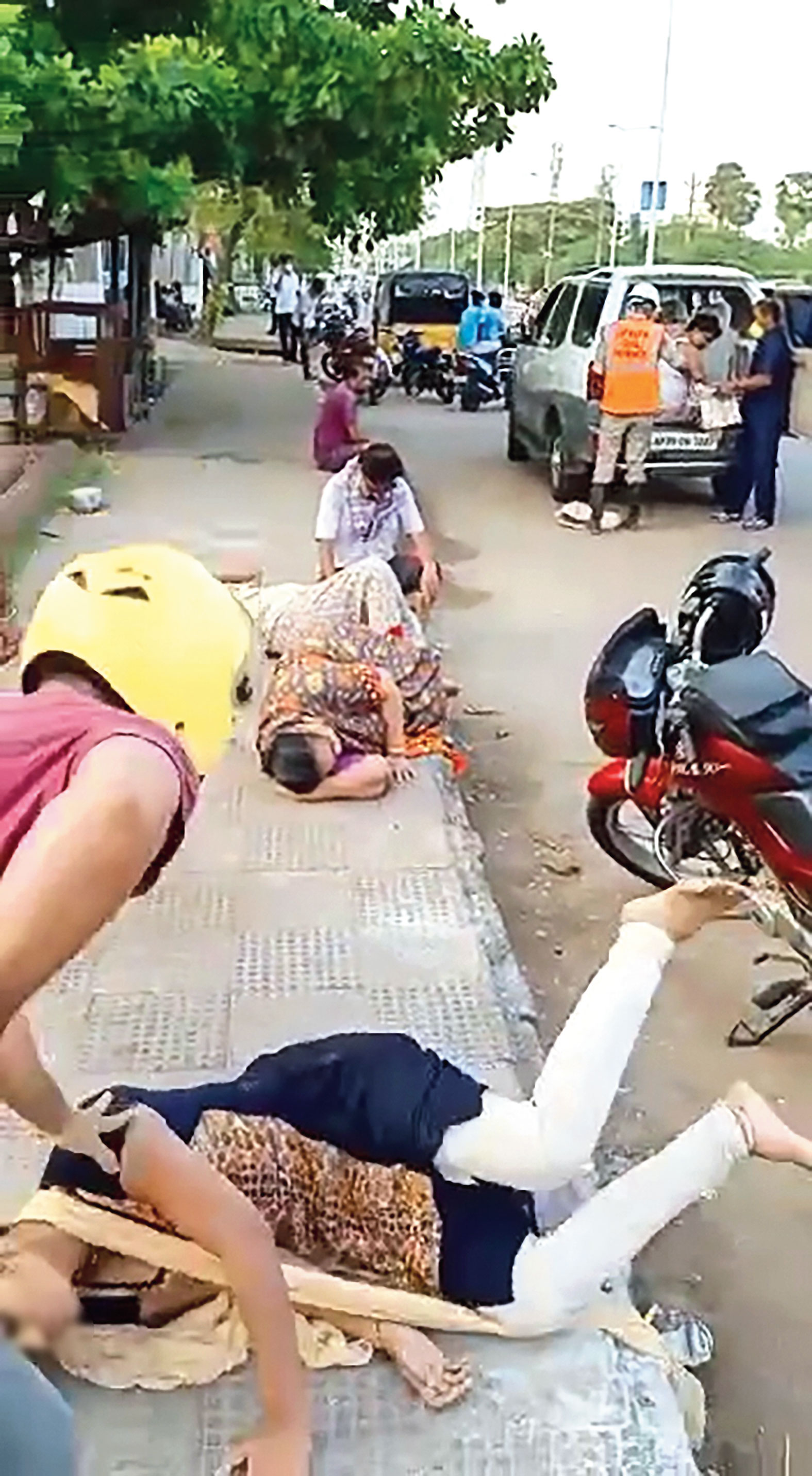 Footage shows a woman falling when she tried to sit after the gas leak at Venkatapuram village, where the LG Polymers plant is located, in Visakhapatnam on Thursday.
