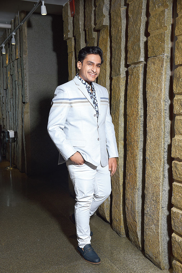 """Ratul felt Aayush to be """"a much more classic dresser"""". He wanted to try a more casual look with him. """"I gave a nice sports jacket, great for a lunch or brunch. I did a very nice sports blazer in linen and silk with an engineered design. We don't want to be overdressed but we want to stand out. This is a great travel piece. There are stripes coming in. I got him a colour that was not too loud and I found it looking very nice on him,"""" he said."""