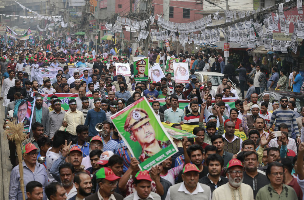Bangladesh's Jatiya Oikya Front supporters display pictures of former president Ziaur Rahman and former prime minister Khaleda Zia during a rally in Dhaka to mark Victory Day, the anniversary of Bangladesh's victory in its war against Pakistan