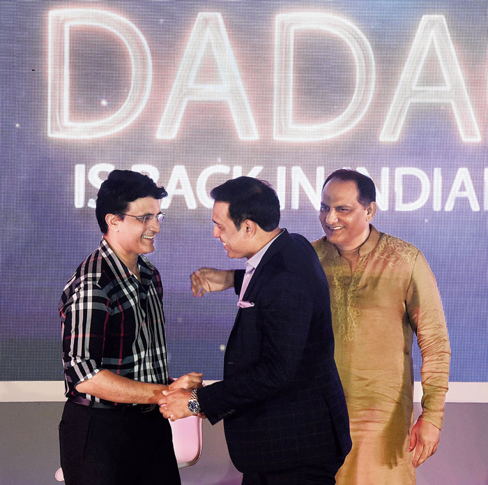 Mohammed Azharuddin and VVS Laxman greet BCCI president Sourav Ganguly during his felicitation at the CAB on Friday