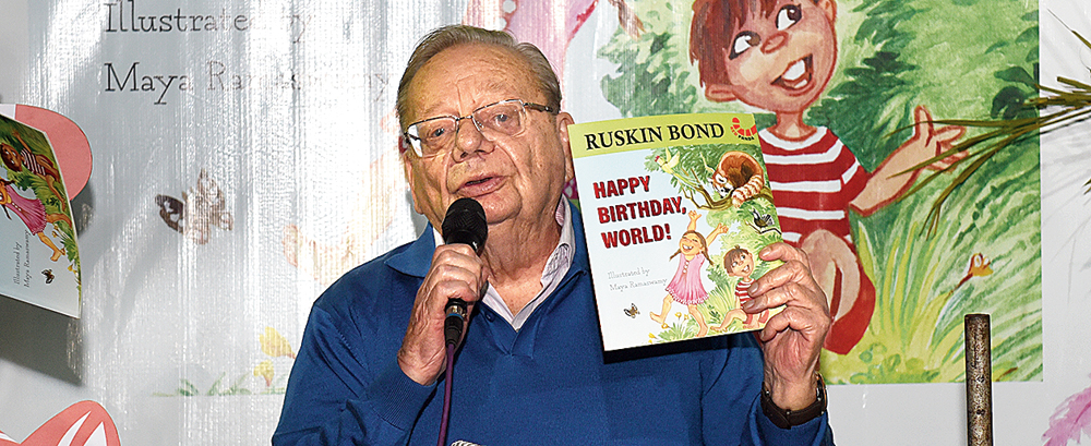 Ruskin Bond at Storyteller Bookstore with a copy of his latest — Happy Birthday, World!