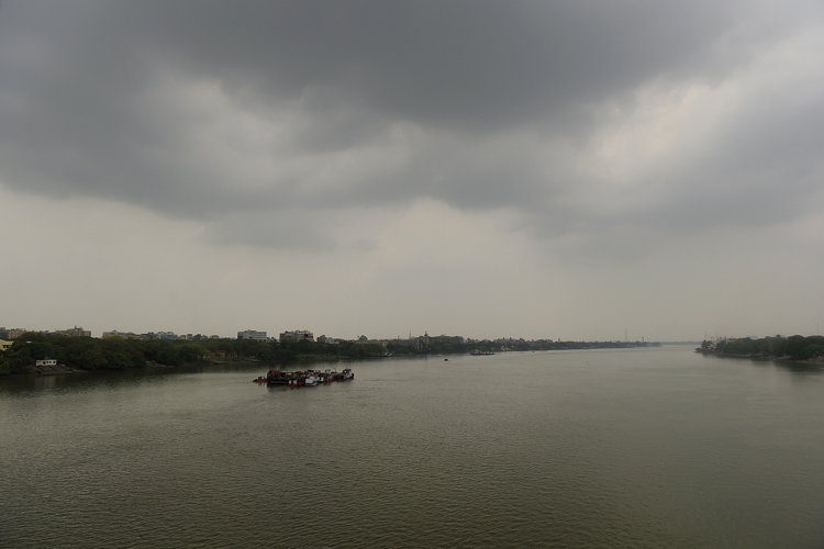 Dark and desolate: An overcast sky over the Hooghly on Wednesday afternoon.