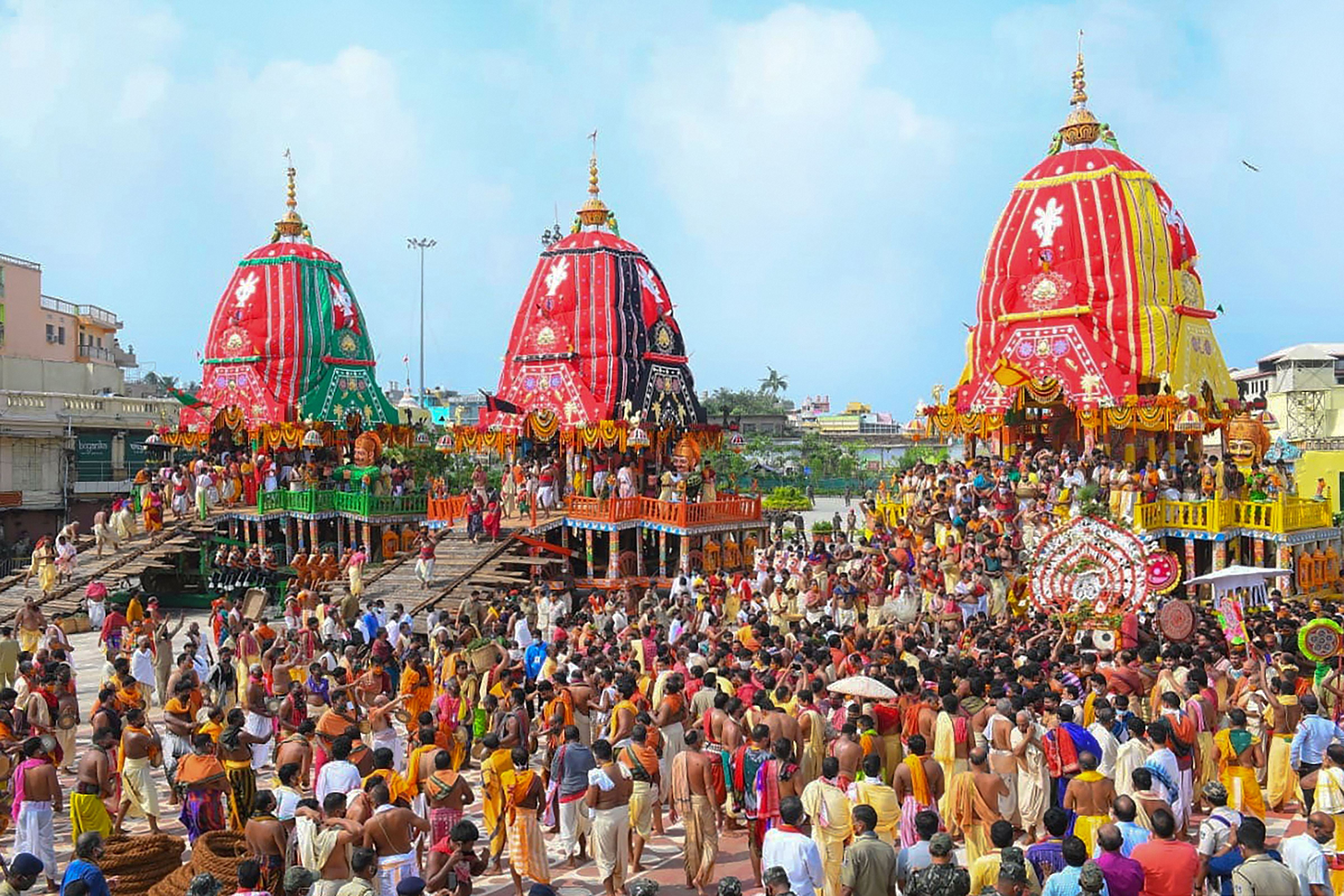 Priests and devotees take part in the pahandi rituals of Jagannath Rath Yatra in Puri on June 23, 2020.