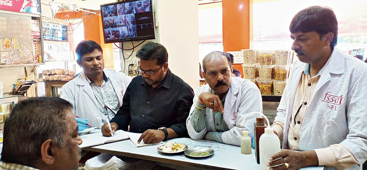 Food samples are tested at a restaurant in Doranda Bazaar, Ranchi, on Ashtami.