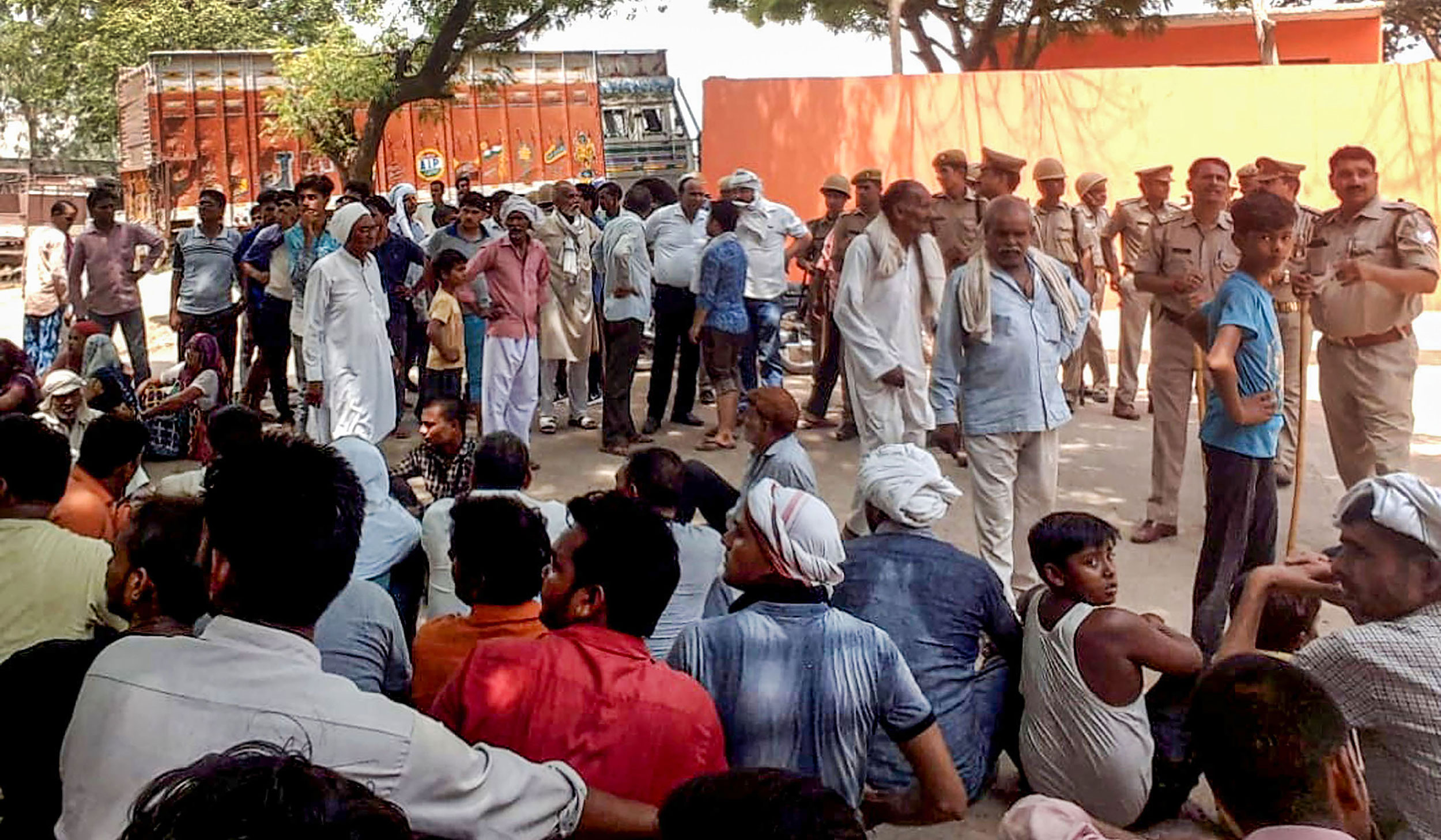 Villagers during a sit-in outside the police station after the killing of a baby girl in Aligarh on June 7, 2019.