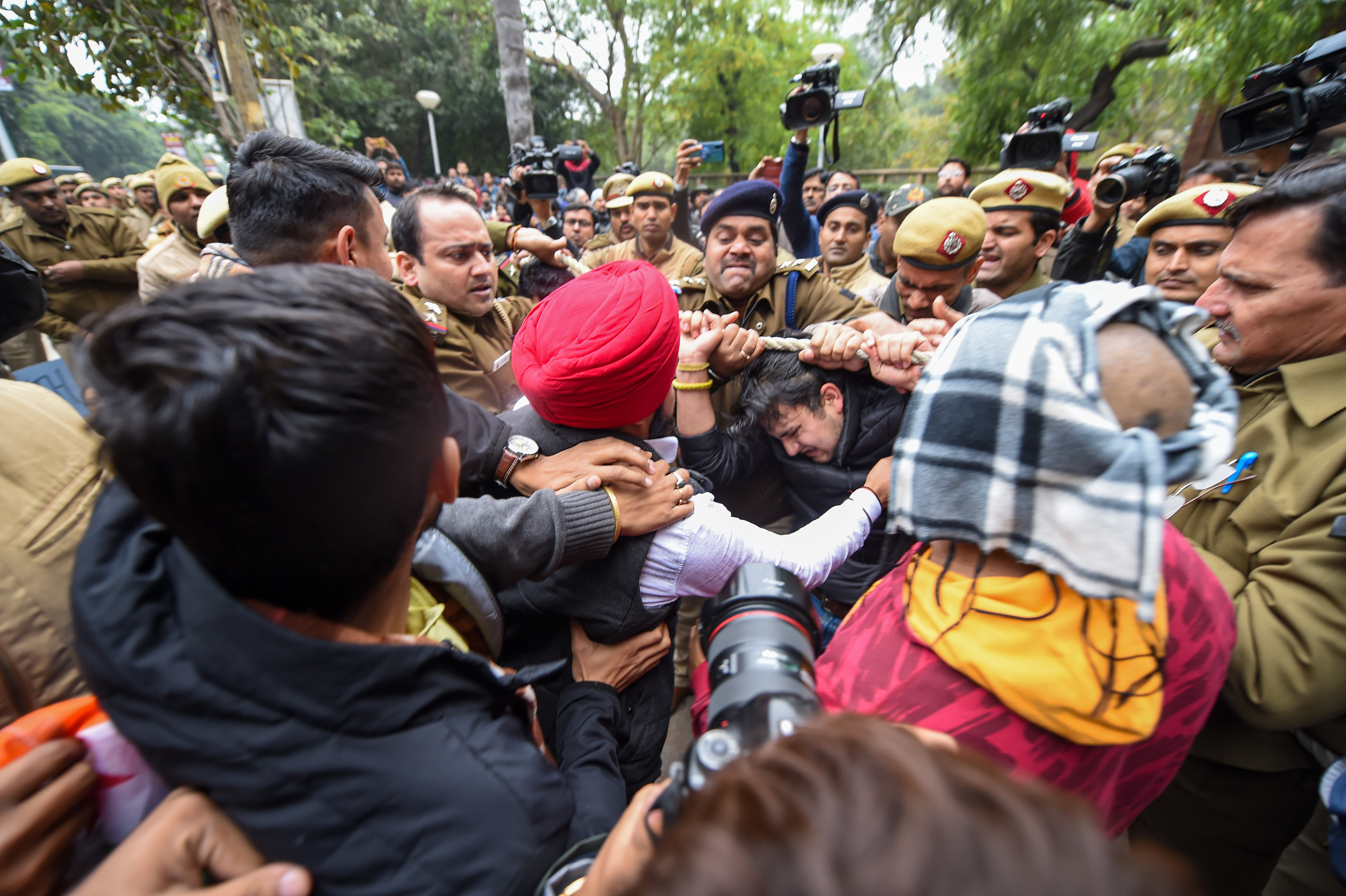 Police detain NSUI members at Delhi University campus in New Delhi, Monday, December 16, 2019.  Several DU students boycotted exams and held protests to express solidarity with students of Jamia and AMU protesting against the amended Citizenship Act.