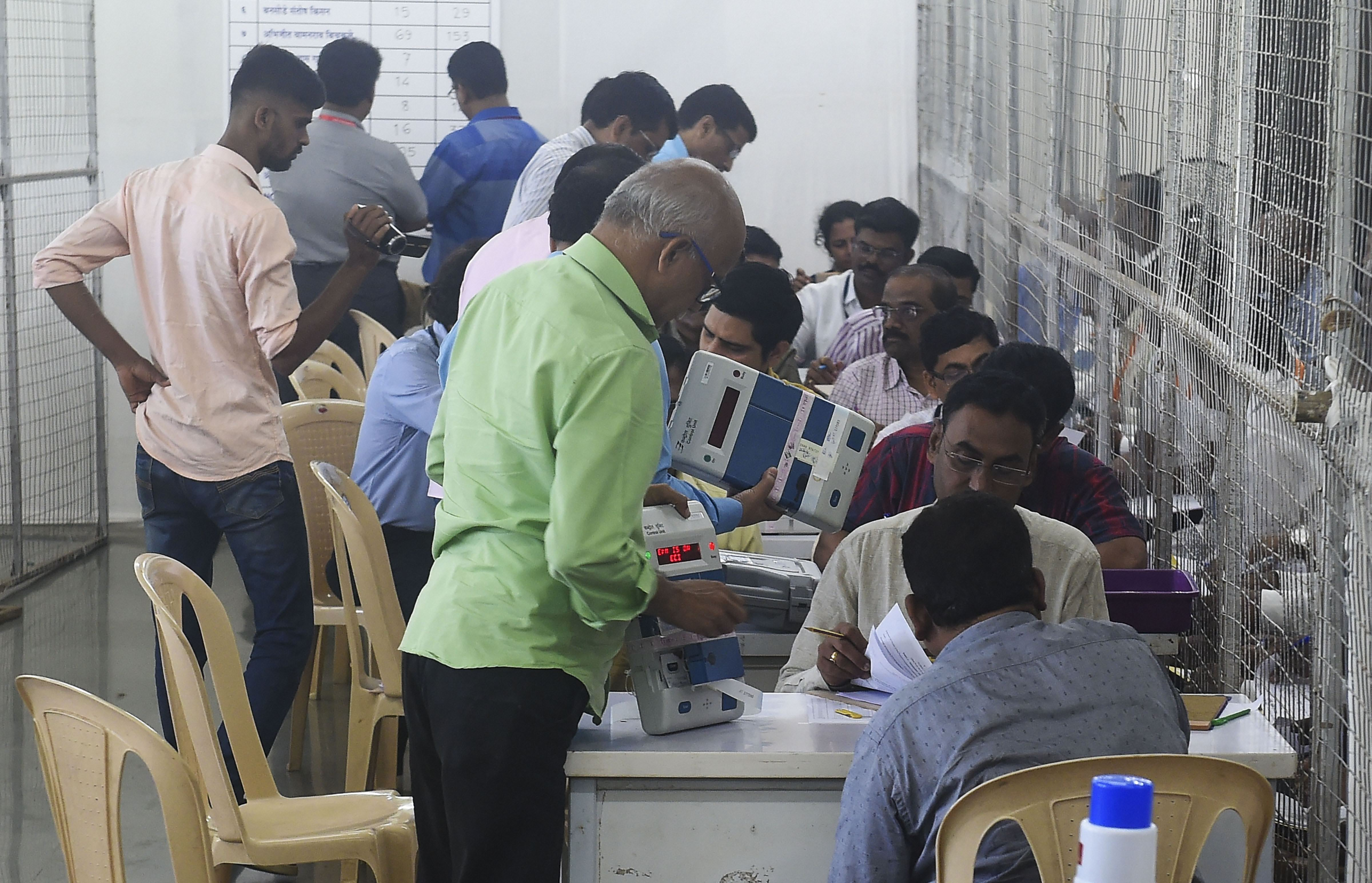 Election officials count of votes for the Maharashtra Assembly elections in Worli, Mumbai, on October 24.