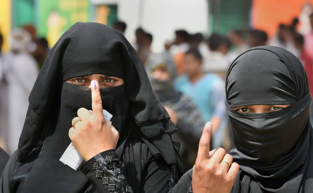Women after casting their votes in Ghaziabad on Thursday
