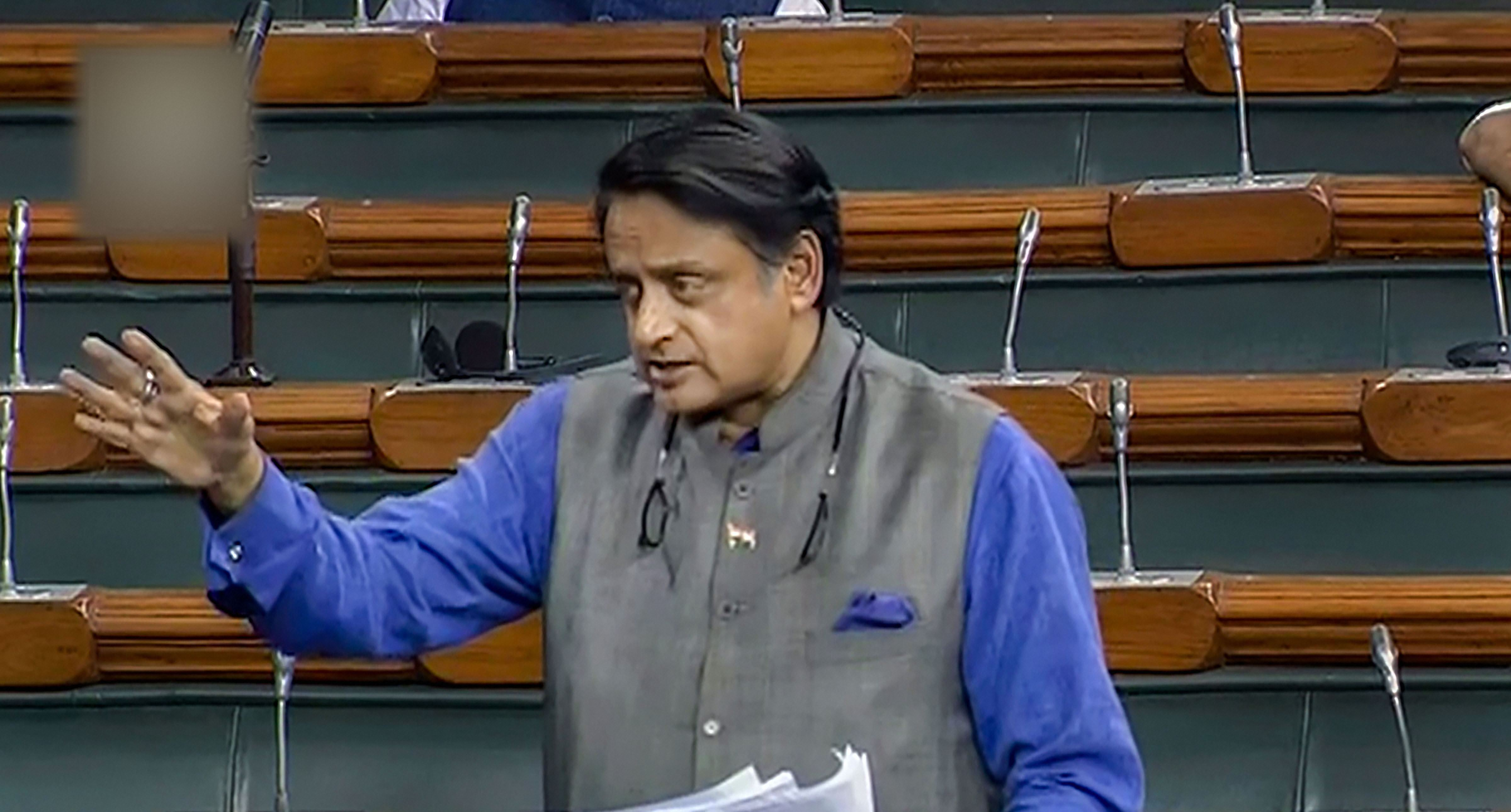 Congress member Shashi Tharoor speaks in the Lok Sabha during the ongoing winter session of Parliament, in New Delhi, Wednesday, December 4, 2019.