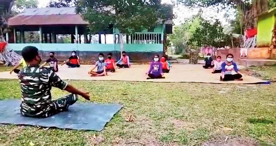Manab Kalita imparts yoga lessons to children at Gobindapur in Assam's Barpeta district.
