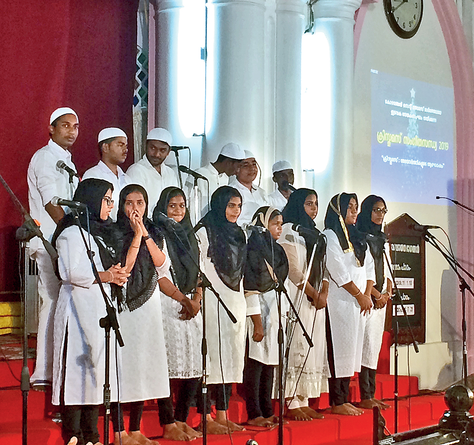Wearing skullcaps and hijab, the youth choir of St Thomas Mar Thoma Church in Kozhenchery, Kerala, performs on Monday