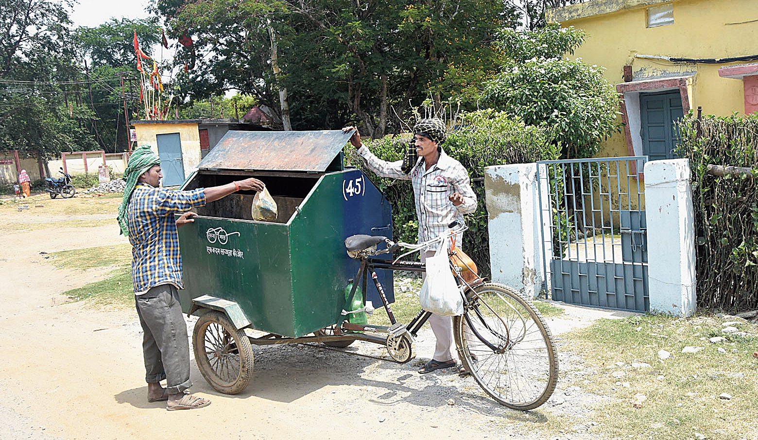DMC workers collect garbage from Jagjivan Nagar in Dhanbad on Friday.
