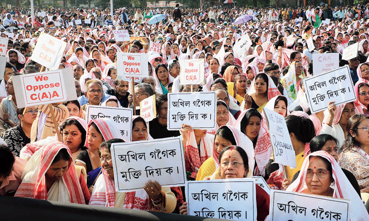 Women protest at Chowkidinghee play ground in Dibrugarh on Monday.