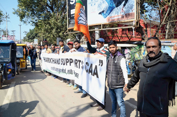 BJP party workers form a human chain on Main Road in Ranchi on Monday in support of the CAA and the NRC.