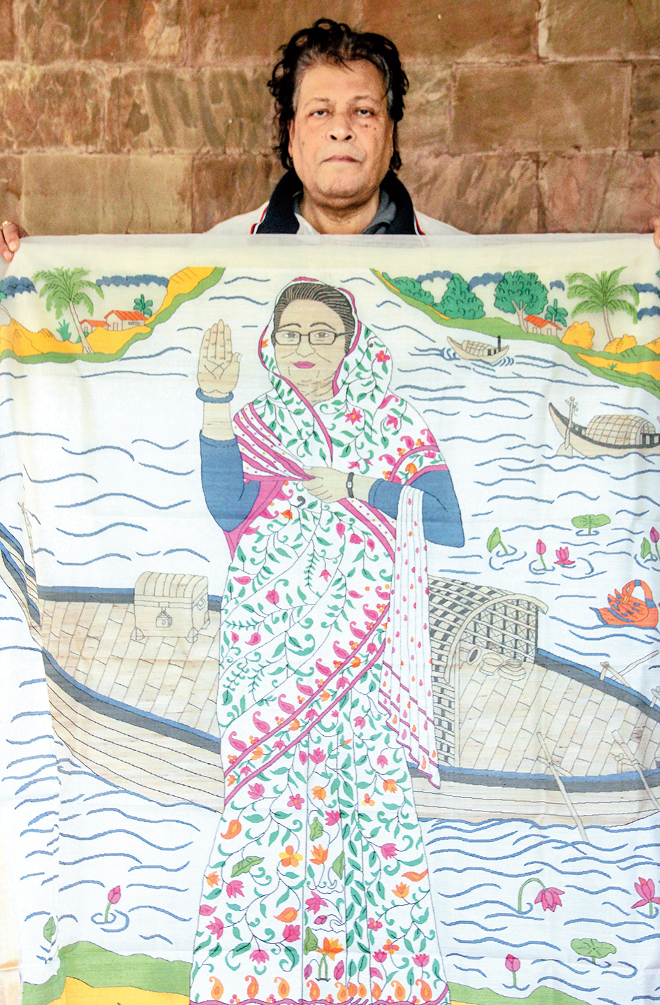 Biren Basak shows the sari with the images of Sheikh Hasina and a boat.