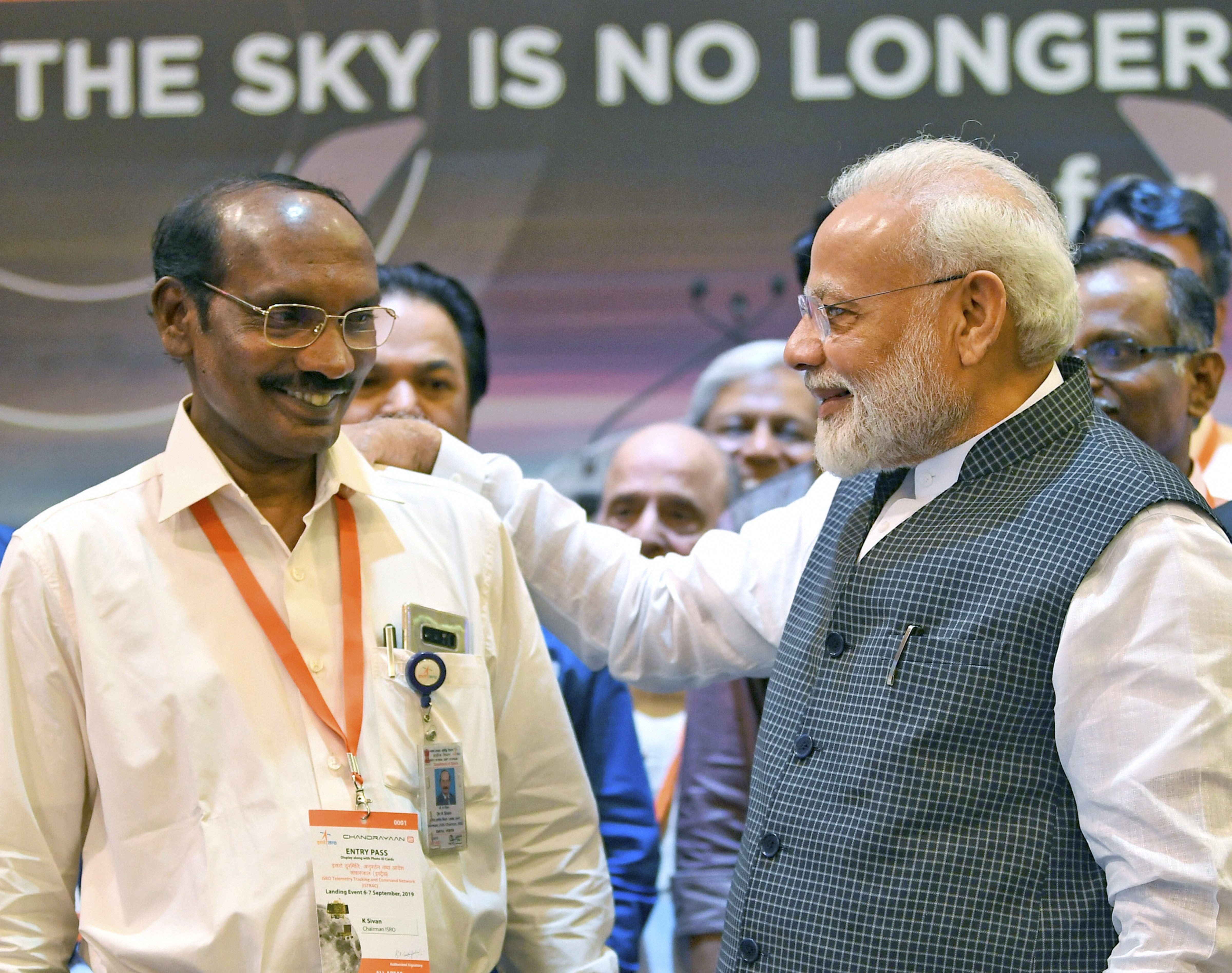 Prime Minister Narendra Modi interacts with Isro chairman Kailasavadivoo Sivan after connection with the Vikram lander was lost during soft-landing of Chandrayaan-2 on lunar surface, in Bengaluru, on Saturday, September 7, 2019.
