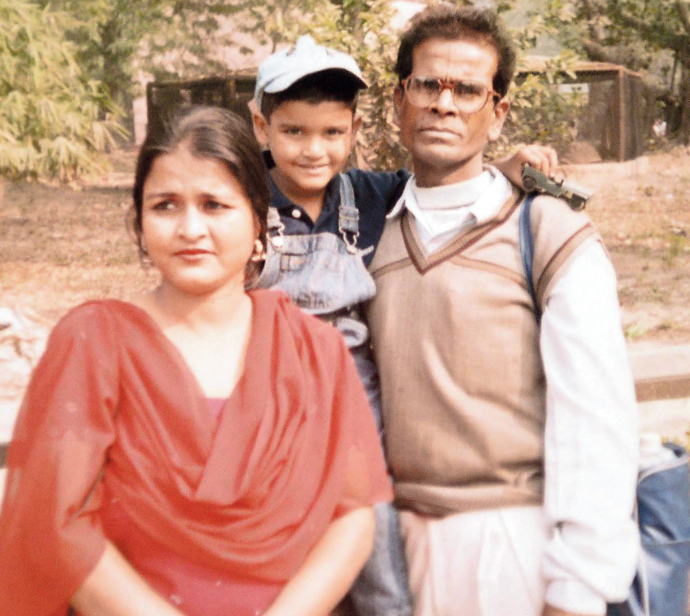 Sajal Kumar Kanjilal with cousin Rajkumar Mukherjee's wife and son.