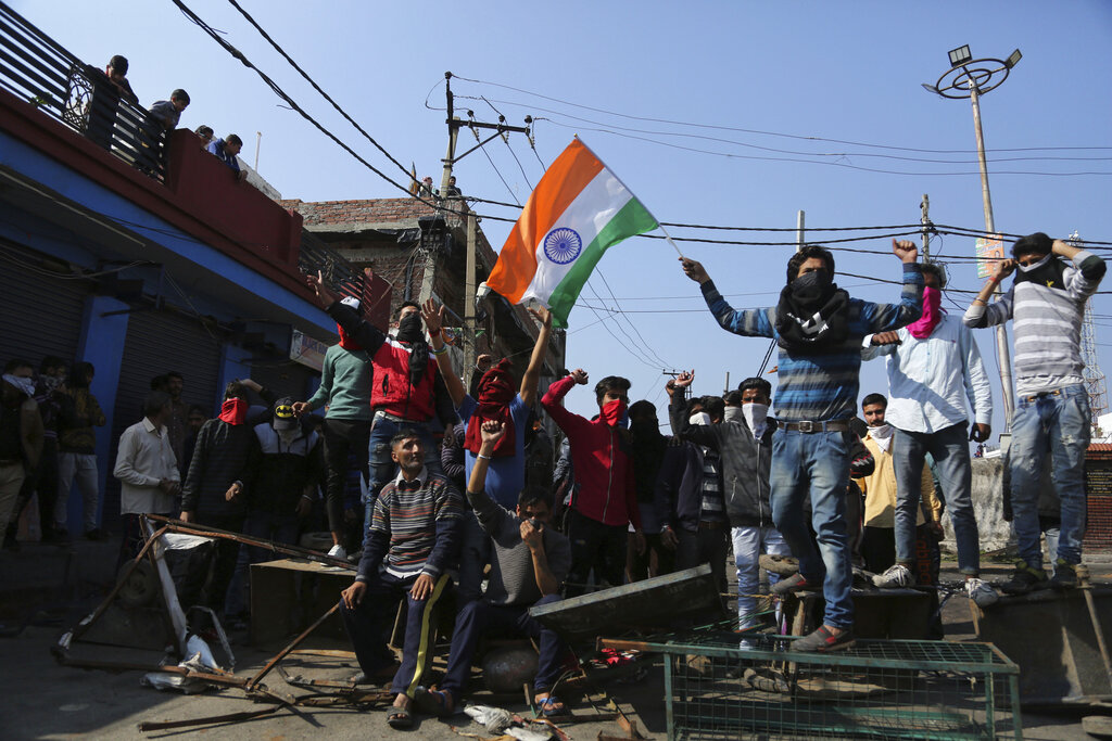 Protesters shout slogans against Pakistan during the second day of curfew in Jammu on Saturday, February 16. The army staged flag marches in sensitive localities after violence was reported during protests against the Pulwama attack