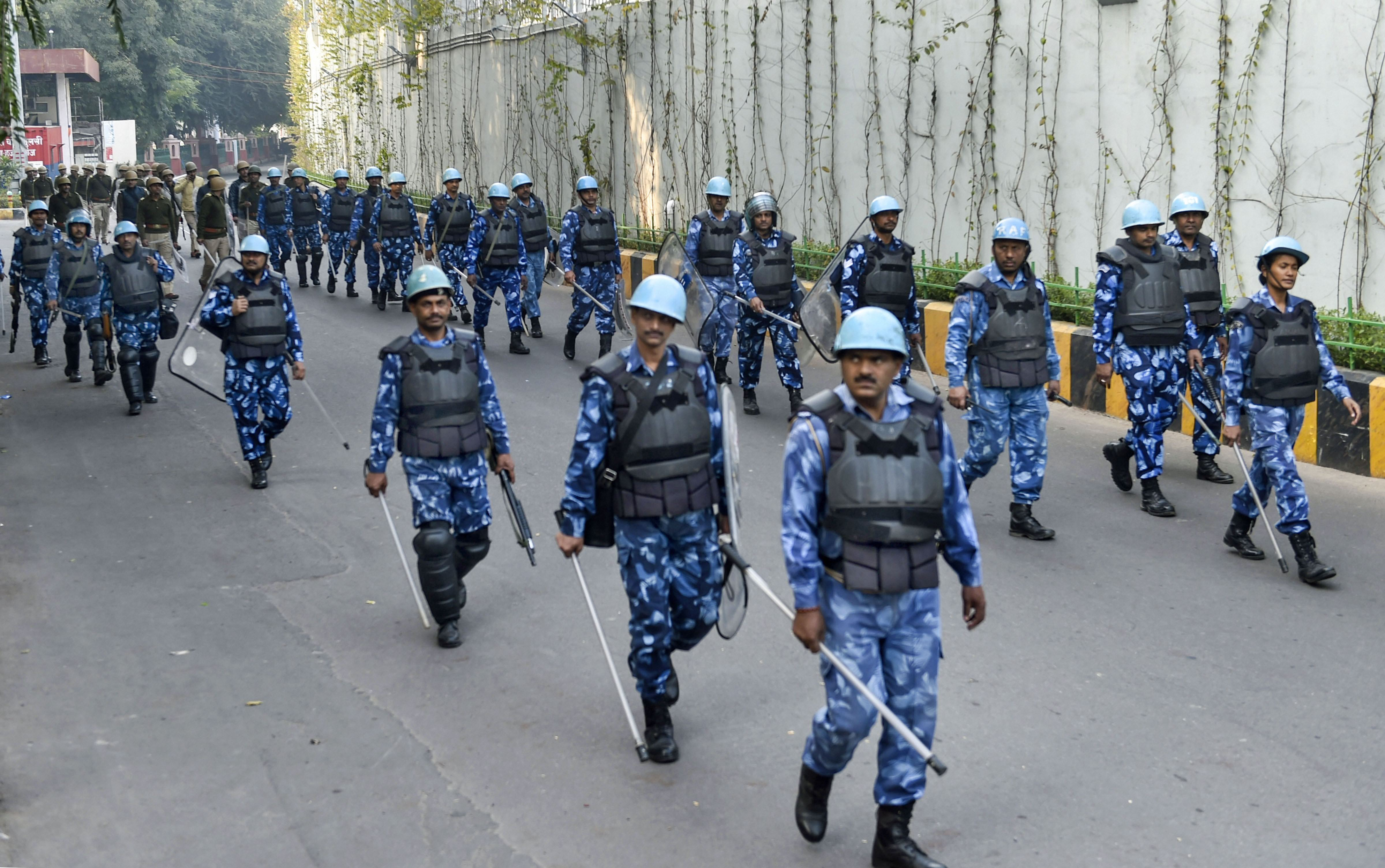 RAF personnel patrol a street, days after protestors resorted to stone-pelting and clashes during agitation against the Citizenship Amendment Act, in Lucknow, Dec. 22, 2019.