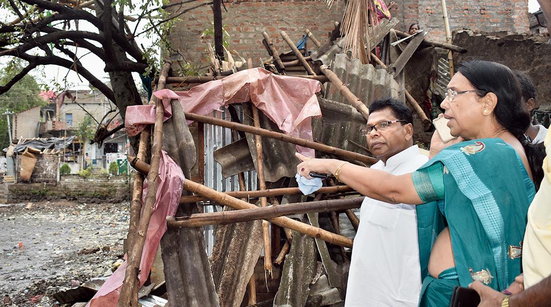 West Midnapore zilla parishad chief Uttara Singha Hazra (right) visits a damaged house on Friday.