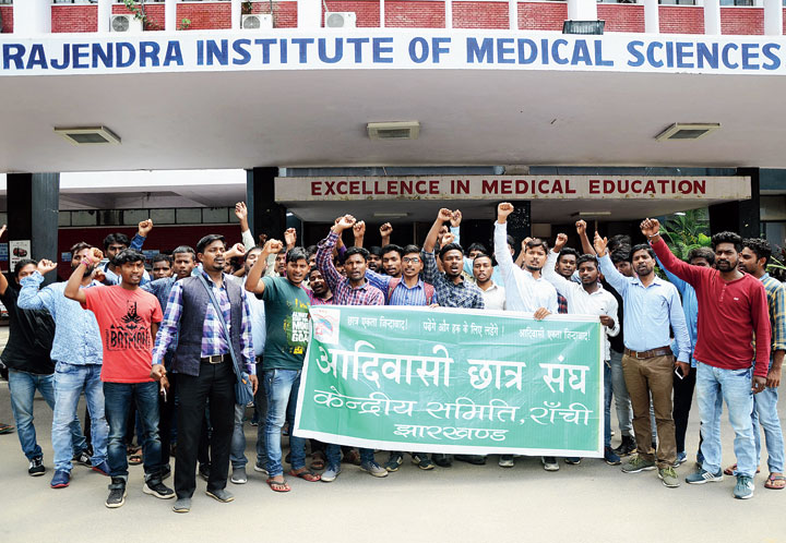 Adivasi Chatra Sangh members protest on the RIMS campus in Ranchi on Thursday