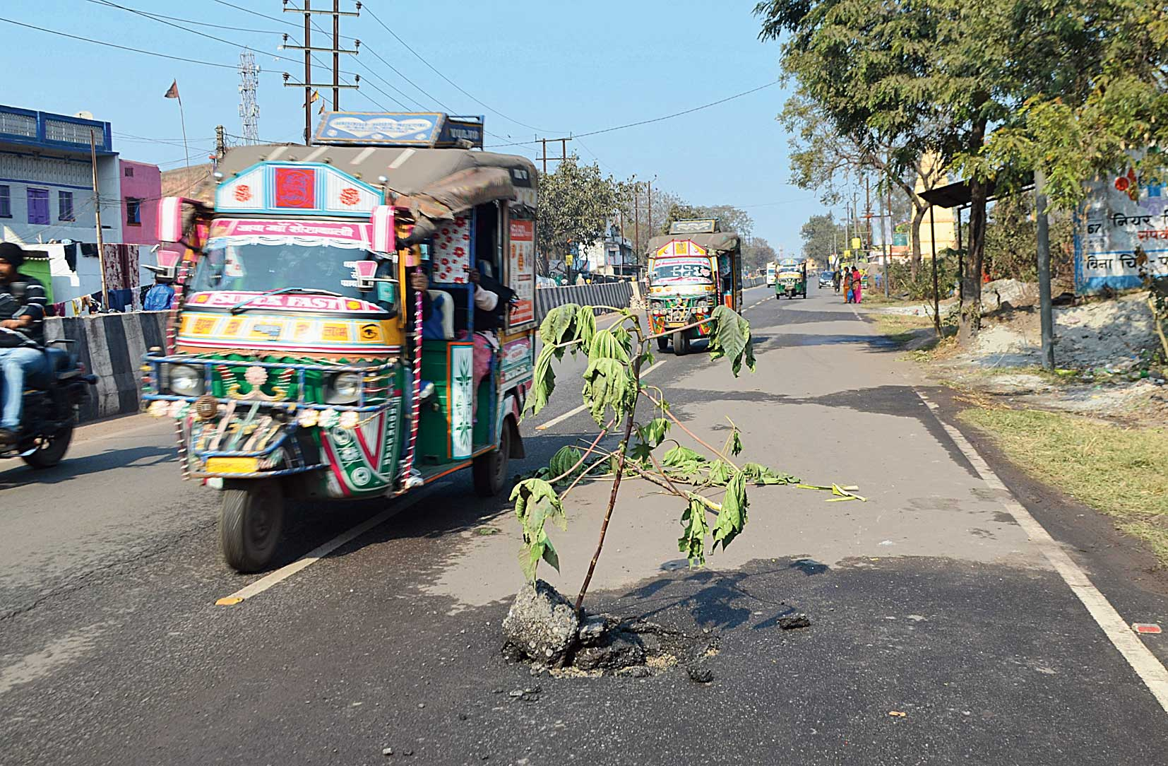 A pothole on Bank More-Sindri Road in Dhanbad on Sunday.