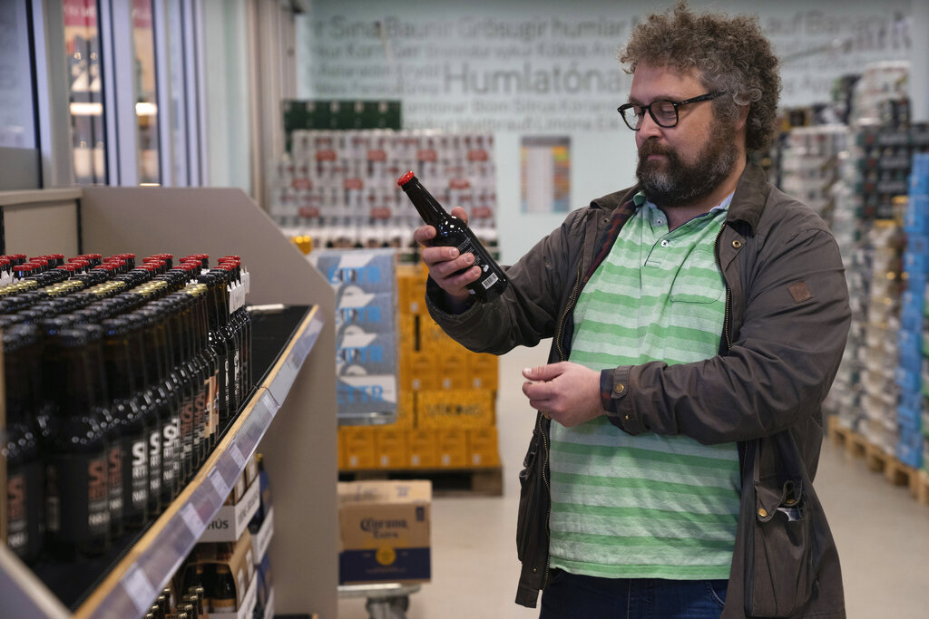 Historian Stefan Palsson checks out the beer selection at a government-run monopoly liquor store in Reykjavik.