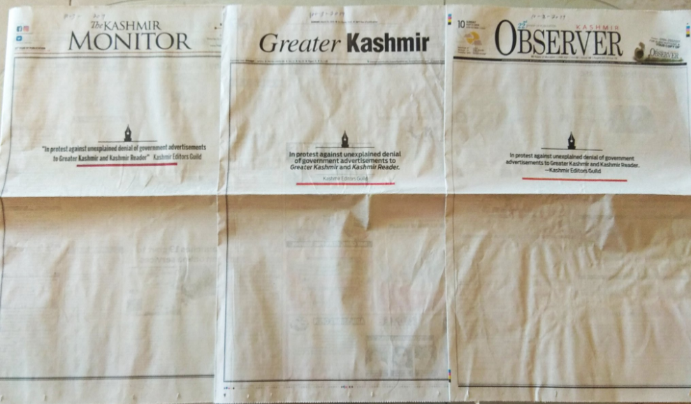 Three Kashmiri newspapers with their blank front pages
