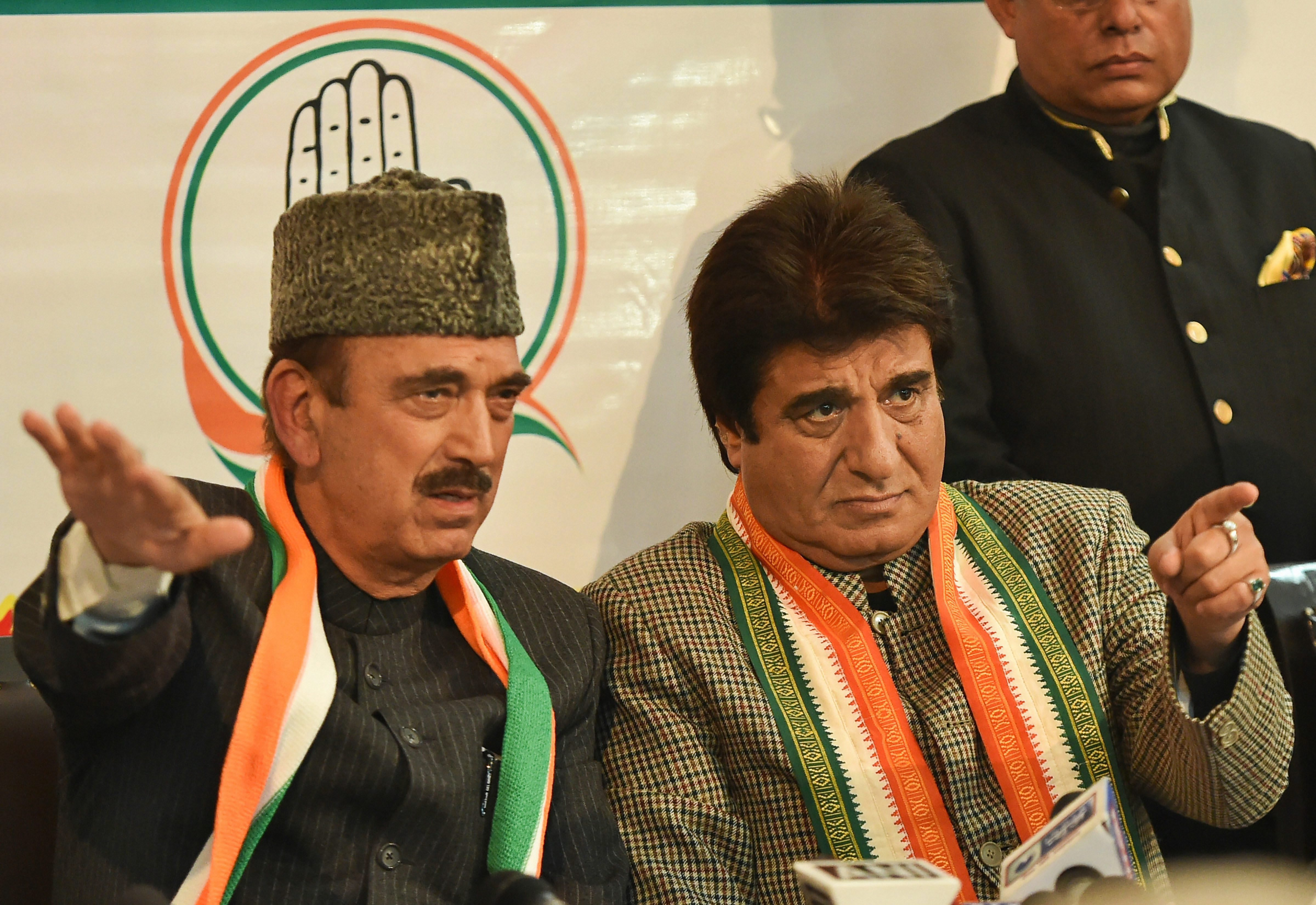 (Left) Senior Congress leader Ghulam Nabi Azad speaks to the media as UP Congress chief Raj Babbar looks on in Lucknow on January 13.