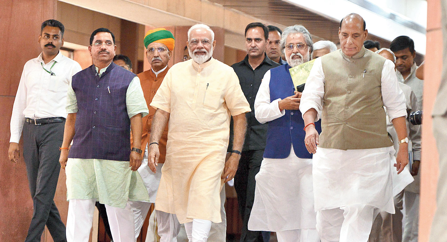 Prime Minister Narendra Modi, defence minister Rajnath Singh (extreme right), Trinamul leader Sudip Bandyopadhyay (second from right) and others after the all-party meeting in New Delhi on Sunday.